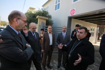 ACN's Executive President (left) listening to Archbishop Warda 's explanation during his  visit to a refugee camp  in northern Iraq.